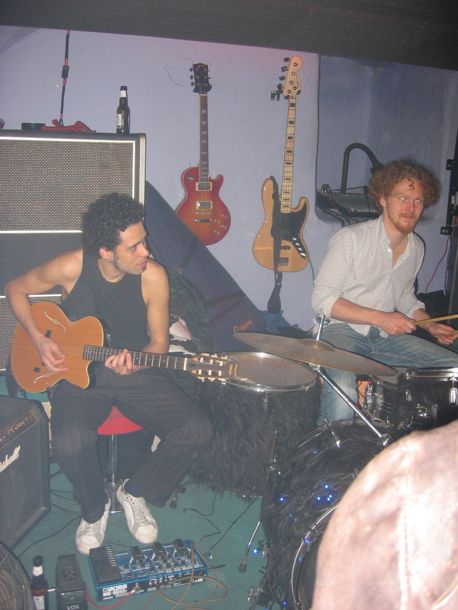 photo of drummer and guitarist jamming at the white cat club
