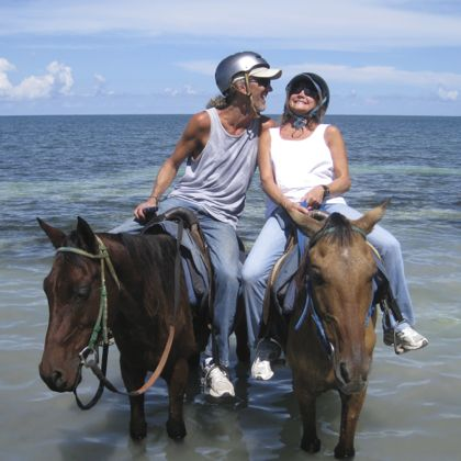 Andy and Barbara laughing on horses in Jamaica, October 2013
