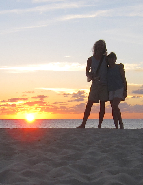 picture of Andy & Barbara on a beach in Anguilla in front of a sunset