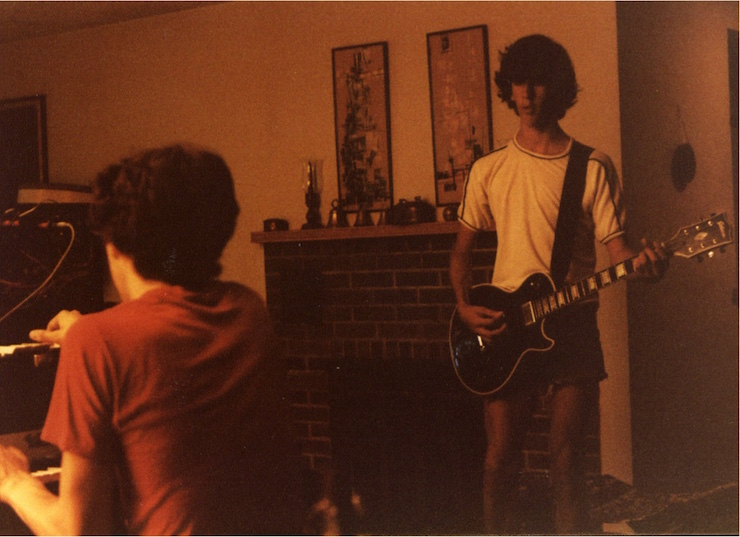 Andy and Doug jamming in 1980 in the living room of their childhood home